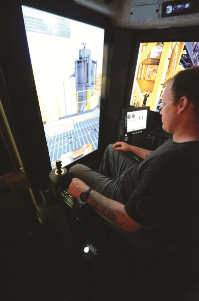 : A student inside a cab of an actual Pit Viper practices drilling during simulator training.